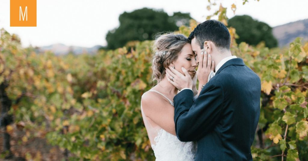 An intimate moment of a couple embracing at Valley of the Moon, Beautiful vines behind them!