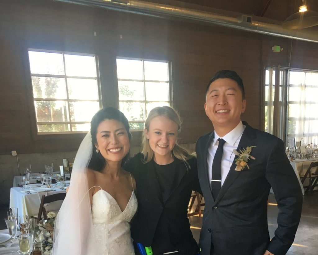 Day-Of Wedding Coordinator with bride and groom