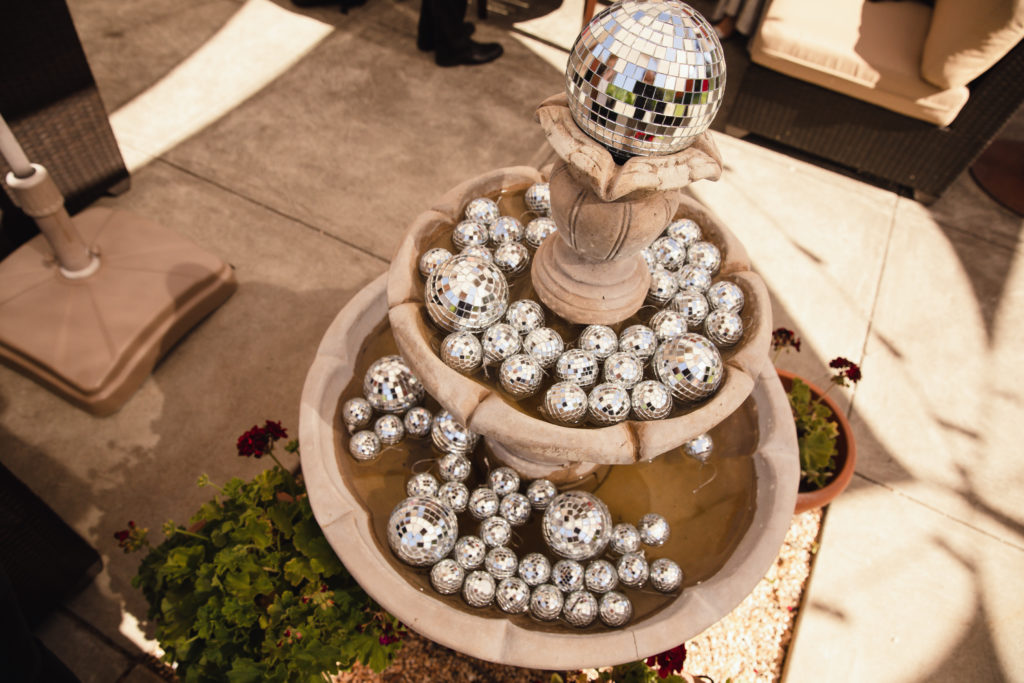 mirrored disco balls in fountain at Valley of the Moon Winery during a wedding